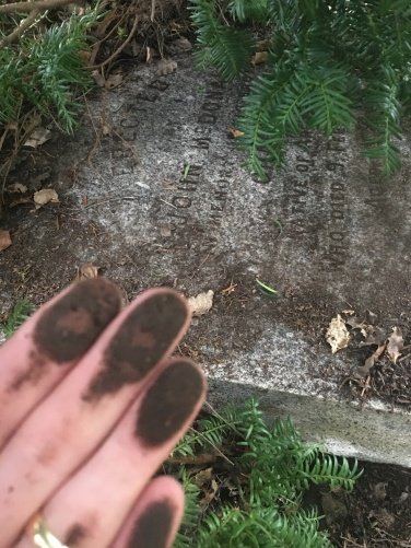 Cleaning of grave marker is dirty work
